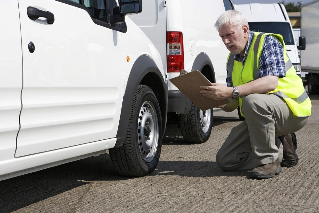Man inspecting work vehicle